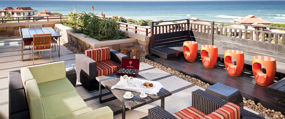 Image of deck overlooking beach at Fairmont Zimbali Resort